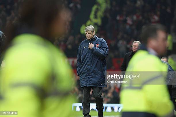 Arsene Wenger of Arsenal walks off after the FA Cup sponsored by e.on Fifth Round match between Manchester United and Arsenal at Old Trafford on...