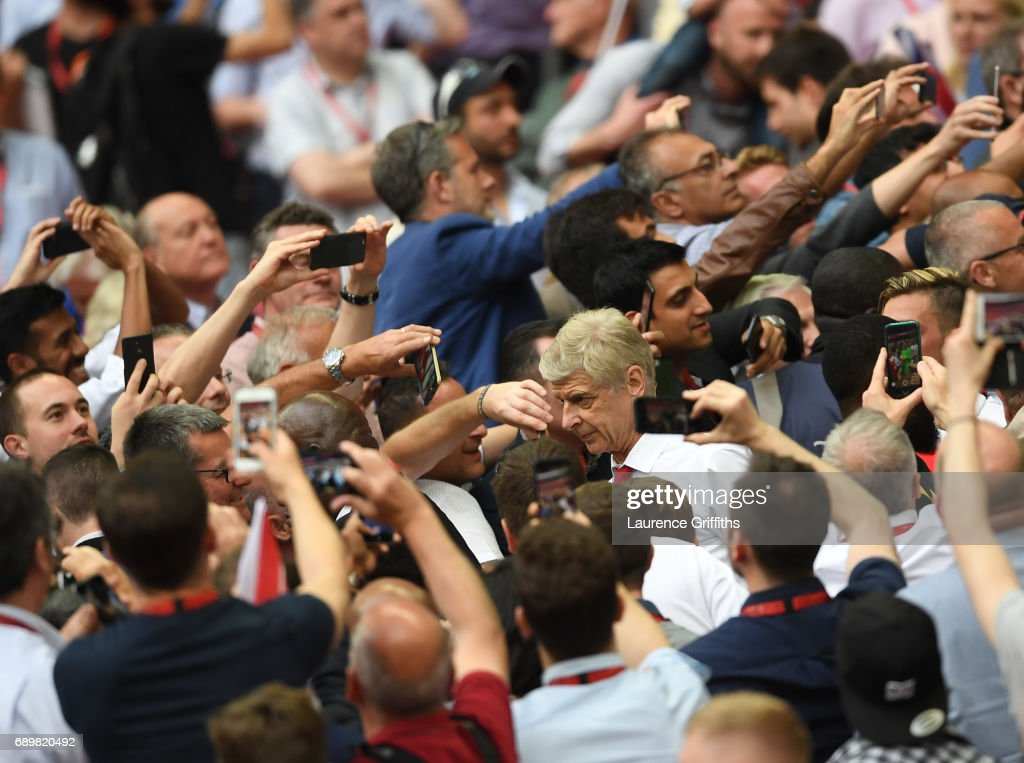 Arsene Wenger of Arsenal walks through the fans after victory in the Emirates FA Cup Final between Arsenal and Chelsea at Wembley Stadium on May 27, 2017 in London, England.