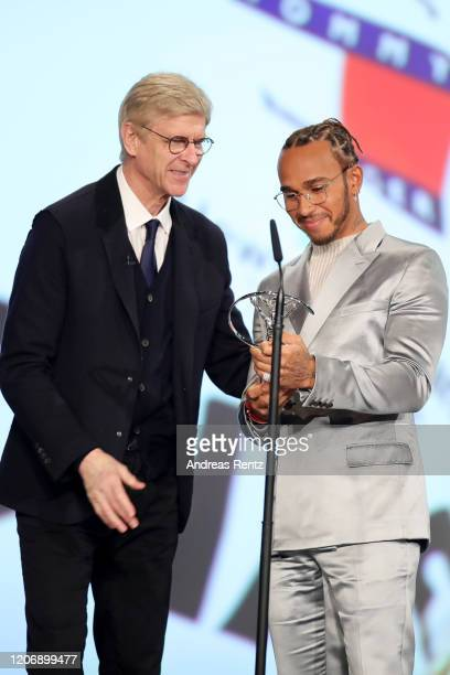Arsene Wenger presents the Laureus World Sportsman of the Year award to British F1 driver Lewis Hamilton on stage during the 2020 Laureus World...