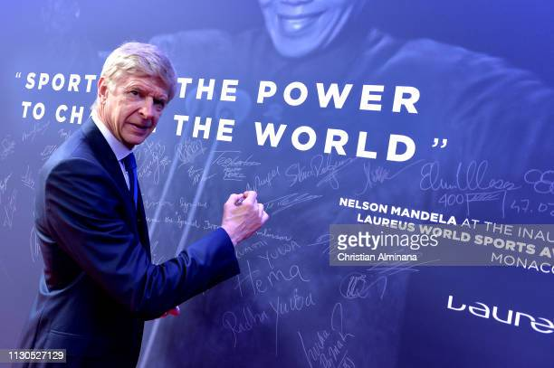 Arsene Wenger signs the Nelson Mandela wall during the 2019 Laureus World Sports Awards on February 18 2019 in Monaco Monaco