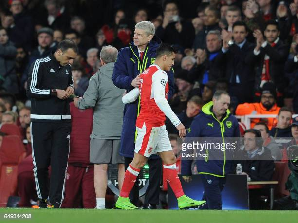 Arsene Wenger the Arsenal Manager and Alexis Sanchez of Arsenal during the UEFA Champions League Round of 16 second leg match between Arsenal FC and...
