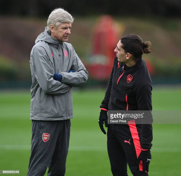 Arsene Wenger the Arsenal manager chats to Hector Bellerin during the Arsenal training session on the eve of the UEFA Europa League group H match...