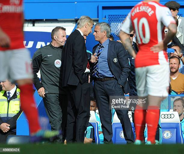 Arsene Wenger the Arsenal Manager clashes chats with Jose Mourinho the Manager of Chelsea during the Barclays Premier League match between Chelsea...