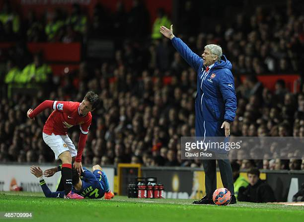 Arsene Wenger the Arsenal Manager during the match between Manchester United and Arsenal in the FA Cup 6th Round at Old Trafford on March 9 2015 in...