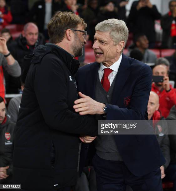 Arsene Wenger the Arsenal Manager greets Jurgen Klopp the Liverpool Manager before the Premier League match between Arsenal and Liverpool at Emirates...