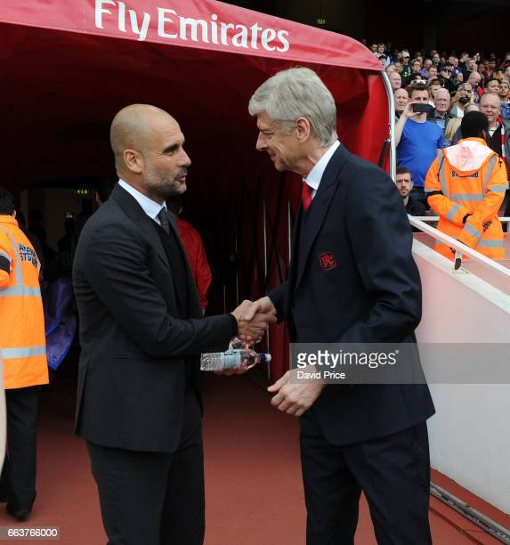 Arsene Wenger the Arsenal Manager greets Pep Guardiola of Manchester City before the Premier League match between Arsenal and Manchester City at...