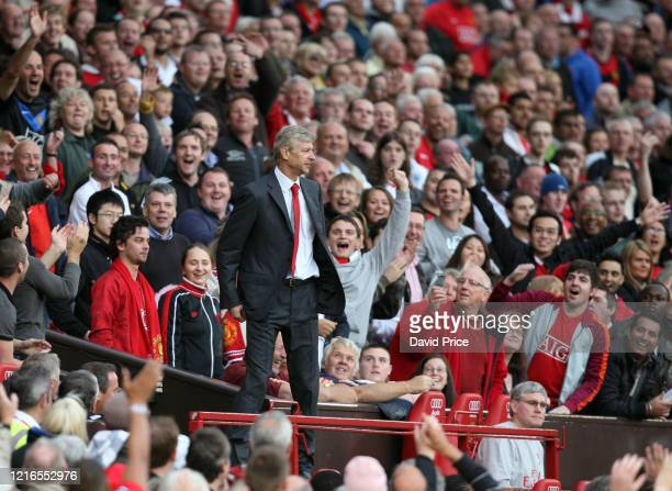 Arsene Wenger the Arsenal Manager is sent to the stands during the Premier League match between Manchester United and Arsenal on March 29 2009 in...