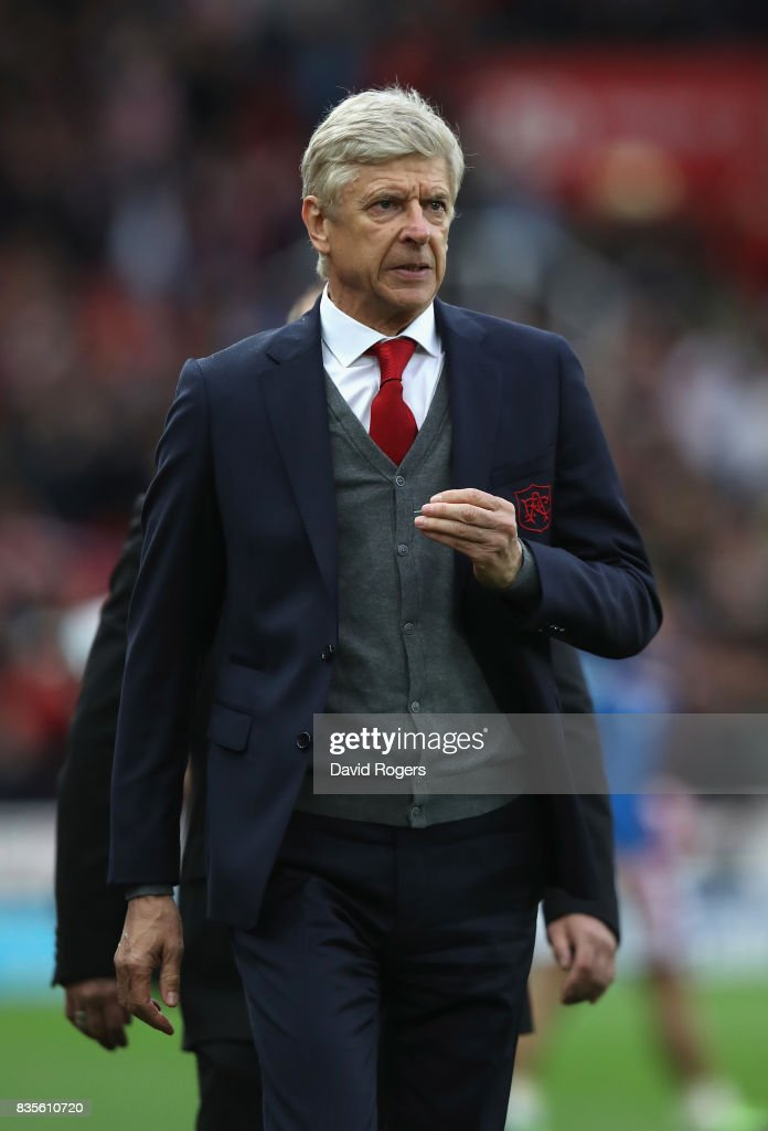 Arsene Wenger, the Arsenal manager looks dejected after their defeat during the Premier League match between Stoke City and Arsenal at Bet365 Stadium on August 19, 2017 in Stoke on Trent, England.