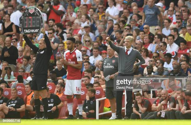 Arsene Wenger the Arsenal Manager passes on instructions as PierreEmerick Aubameyang prepares to come on during the Premier League match between...