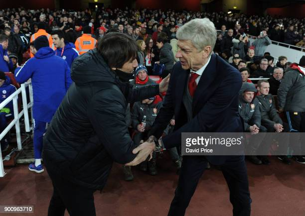 Arsene Wenger the Arsenal Manager shakes hands with Antonio Conte the Chelsea Manager before the Premier League match between Arsenal and Chelsea at...