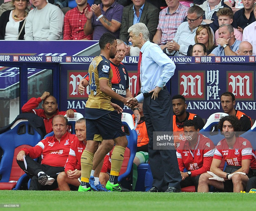 Arsene Wenger the Arsenal Manager shakes hands with Francis Coquelin of Arsenal and he comes off the pitch having been substituted during during the Barclays Premier League match between Crystal Palace and Arsenal on August 16, 2015 in London, United Kingdom.