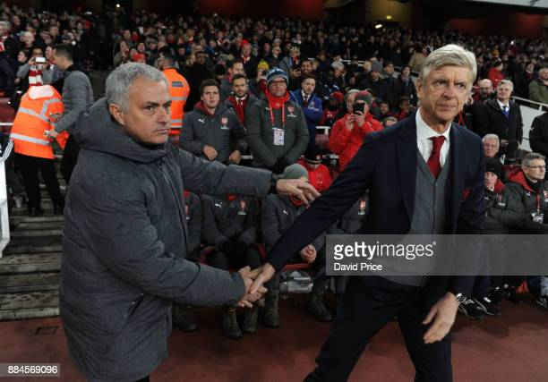 Arsene Wenger the Arsenal Manager shakes hands with Jose Mourinho the Manager of Man Utd before the Premier League match between Arsenal and...