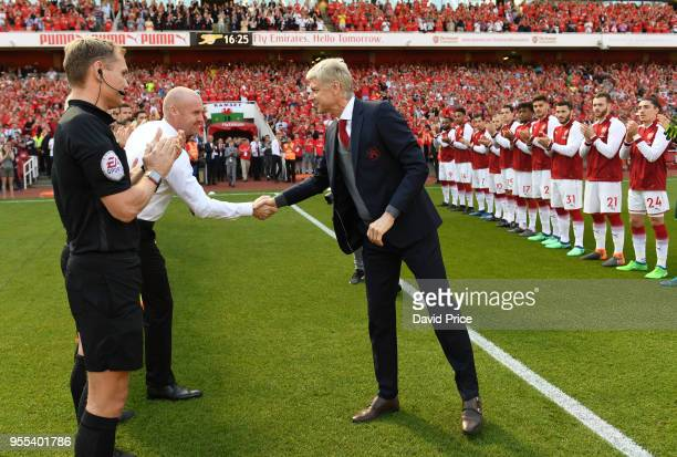 Arsene Wenger the Arsenal Manager shakes hands with Shaun Dyche the Manager of Burnley the Premier League match between Arsenal and Burnley at...