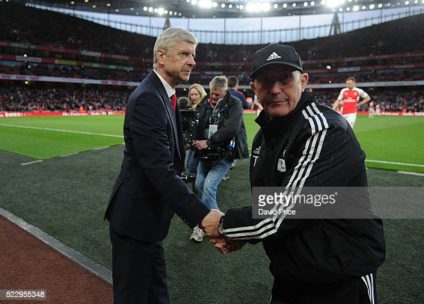 Arsene Wenger the Arsenal Manager shakes hands with Tony Pulis the Manager of WBA before the Barclays Premier League match between Arsenal and West...