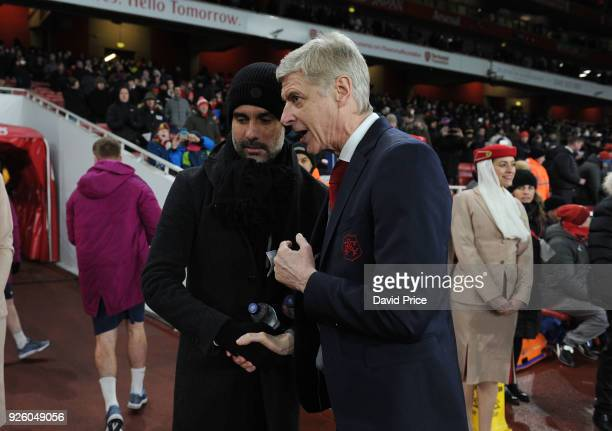 Arsene Wenger the Arsenal Manager speaks to Pep Guardiola the Man City Manager before the Premier League match between Arsenal and Manchester City at...