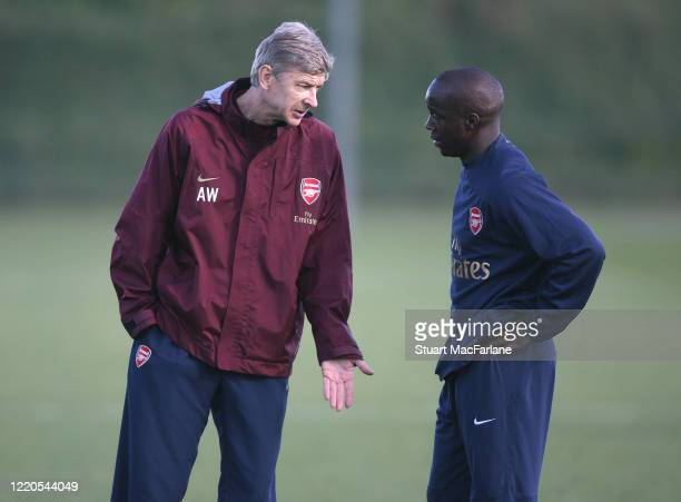 Arsene Wenger the Arsenal Manager talks to Lassana Diarra during an Arsenal training session on October 30, 2007 in St. Albans, England.