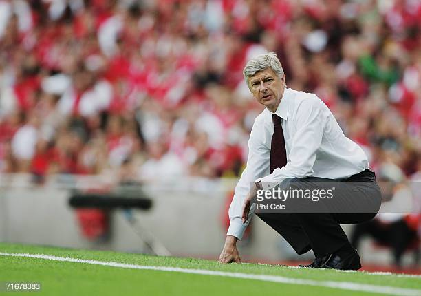 Arsene Wenger, the Arsenal Manager, watches from the touchline during the Barclays Premiership match between Arsenal and Aston Villa at The Emirates...