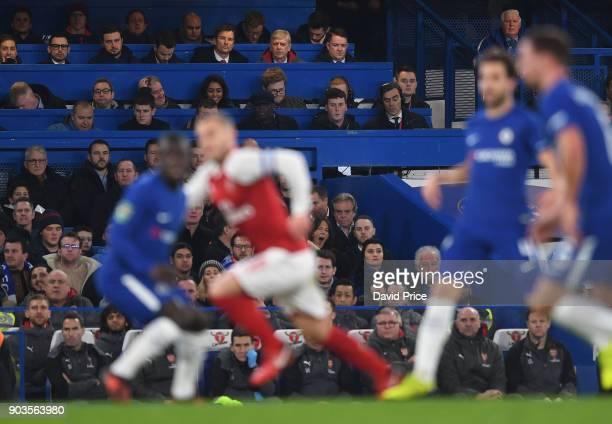 Arsene Wenger the Arsenal Manager watches the match from the press box during the Carabao Cup Semie Final 1st leg match between Chelsea and Arsenal...