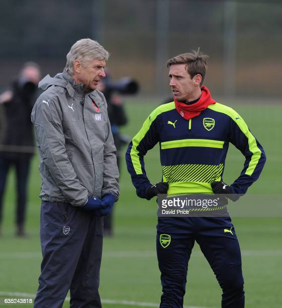 Arsene Wenger the Arsenal Manager with Nacho Monreal during the Arsenal Training Session at London Colney on February 14, 2017 in St Albans, England.