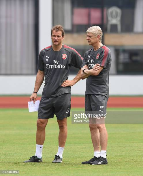 Arsene Wenger the Manager of Arsenal and Arsenal 1st team coach Jens Lehmann during an Arsenal Training Session at Yuanshen Sports Centre Stadium on...