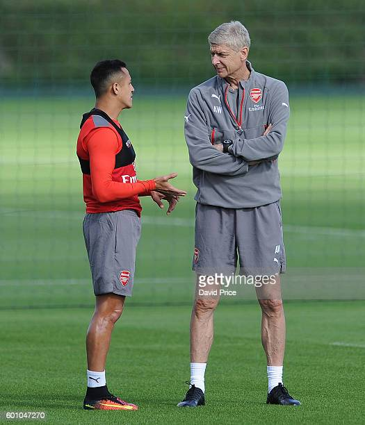 Arsene Wenger the Manager of Arsenal chats to Alexis Sanchez of Arsenal during Arsenal Training Session at London Colney on September 9 2016 in St...