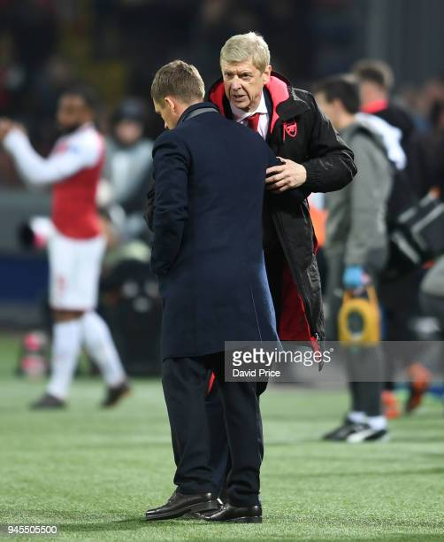 Arsene Wenger the Manager of Arsenal chats to Viktor Goncharenko the Manager of CSKA after the UEFA Europa League quarter final leg two match between...