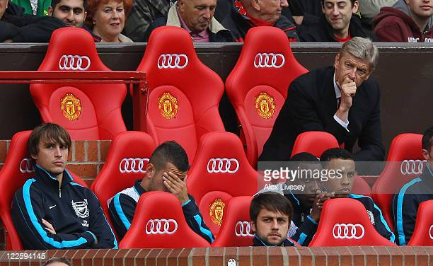 Arsene Wenger the manager of Arsenal looks on during the Barclays Premier League match between Manchester United and Arsenal at Old Trafford on...