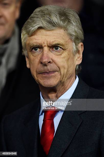 Arsene Wenger the manager of Arsenal looks on during the FA Cup Quarter Final match between Manchester United and Arsenal at Old Trafford on March 9...