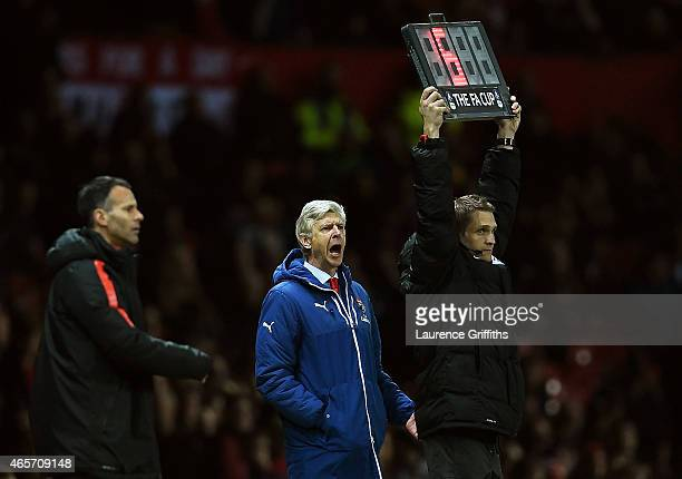 Arsene Wenger the manager of Arsenal reacts during the FA Cup Quarter Final match between Manchester United and Arsenal at Old Trafford on March 9...