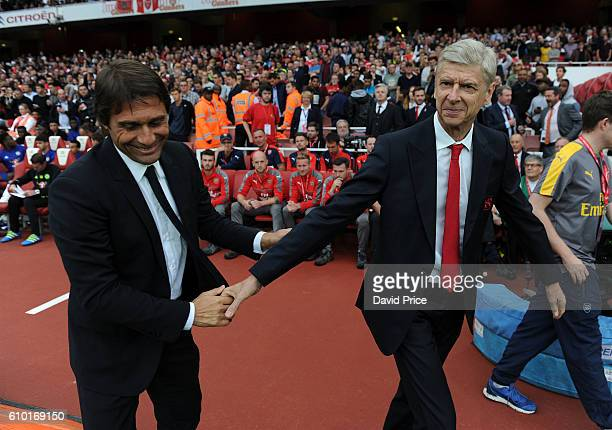 Arsene Wenger the Manager of Arsenal shakes hands with Antonio Conte the Chelsea Manager before the Premier League match between Arsenal and Chelsea...