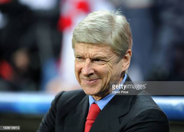Arsene Wenger the Manager of Arsenal smiles during the UEFA Champions League Round of 16 second leg match between Bayern Muenchen and Arsenal FC at...