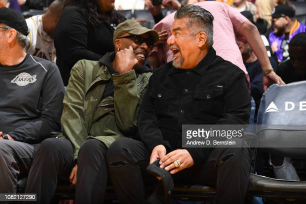 Arsenio Hall and George Lopez laugh during a game between the Cleveland Cavaliers and the Los Angeles Lakers on January 13 2019 at STAPLES Center in...