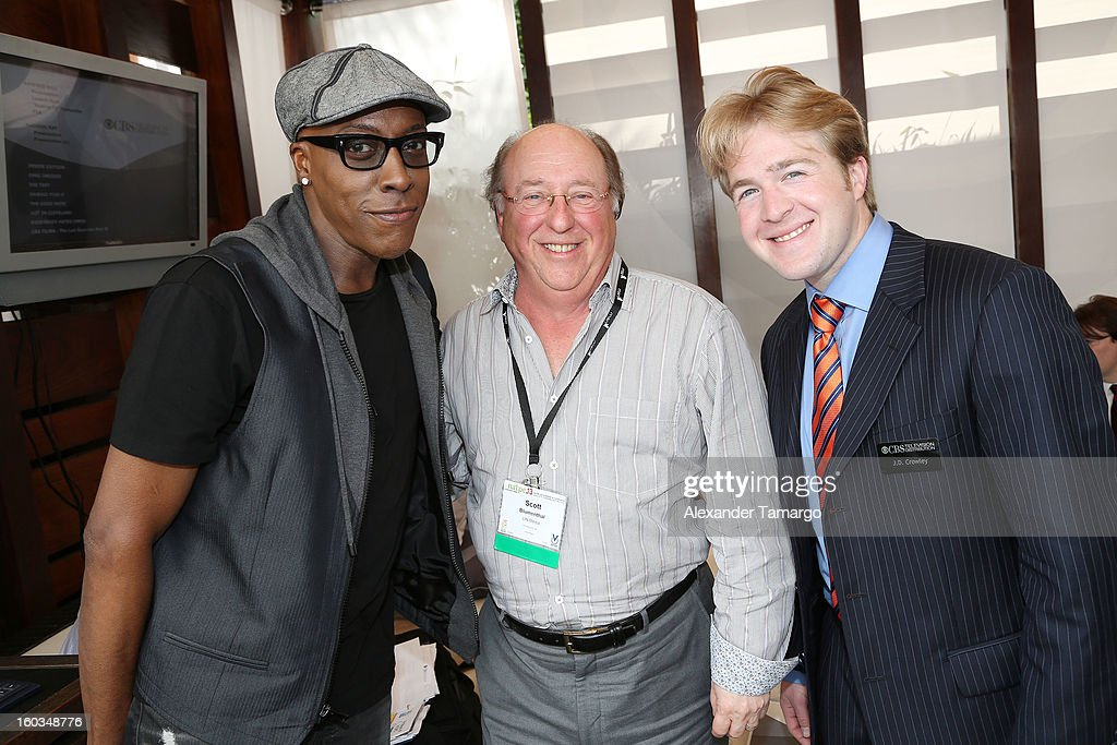 Arsenio Hall, Scott Blumenthal and J.D. Crowley are seen at the CBS Television Distribution cabana during NATPE at Fontainebleau Miami Beach on January 29, 2013 in Miami Beach, Florida.