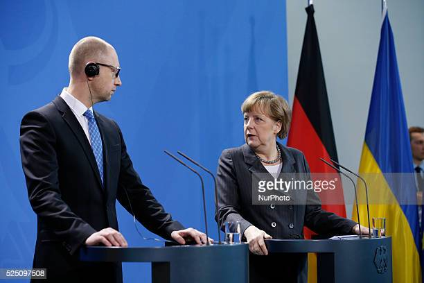 Arseniy Yatsenyuk Prime Minister of Ukraine and the German Chancellor Angela Merkel during a joint press conference at the German Chancellery in...