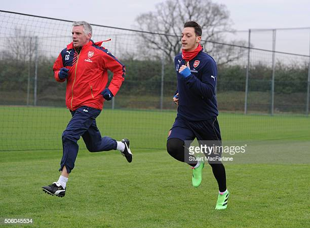 Arsenla fitness coach Craig Gant with Mesut Ozil during a training session at London Colney on January 21 2016 in St Albans England