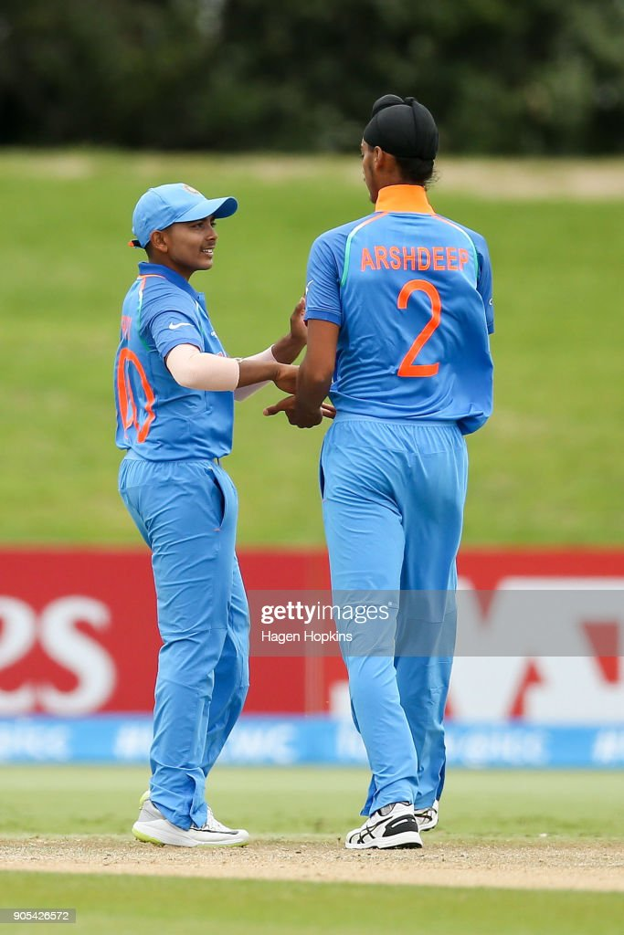 Arshdeep Singh of India celebrates with captain Prithvi Shaw of India after taking the wicket of Vagi Karaho of Papua New Guinea during the ICC U19 Cricket World Cup match between India and Papua New Guinea at Bay Oval on January 16, 2018 in Tauranga, New Zealand.