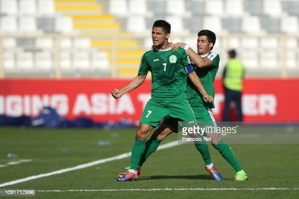 Arslanmurat Amanov of Turkmenistan celebrates with a team mate after he scored their team's first goal during the AFC Asian Cup Group F match between...
