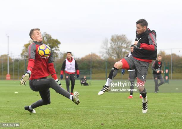 Arsneal goalkeeper Matt Macey saves from Mathieu Debuchy during a training session at London Colney on November 14 2017 in St Albans England