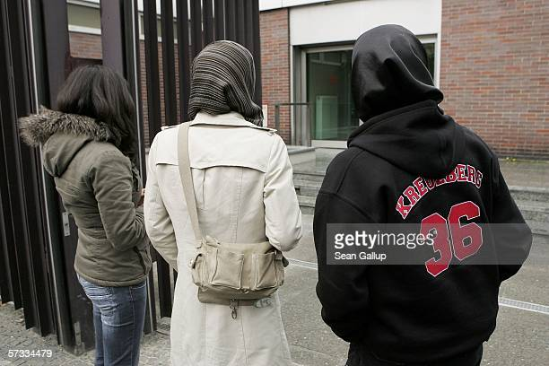 Arsu and Songol Surucu sisters of Alpaslan and Mutlu Surucu and a friend wait for their two brothers outside a Berlin courthouse after a court...