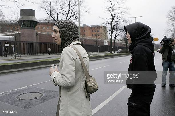 Arsu and Songol Surucu sisters of Alpaslan and Mutlu Surucu cross a street while waiting for their two brothers outside a Berlin courthouse after a...