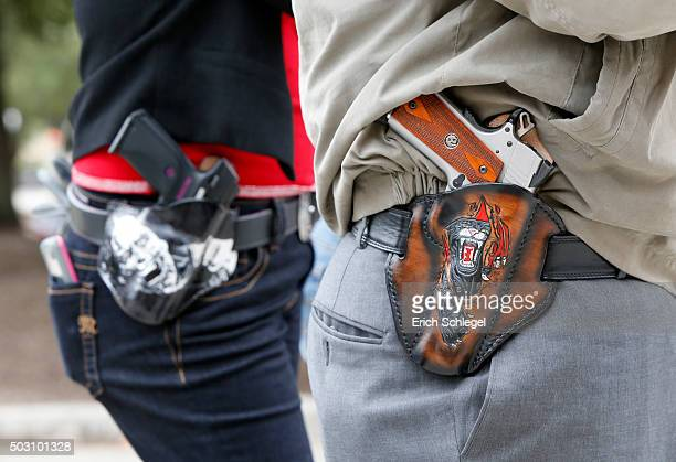 Art and Diana Ramirez of Austin with their pistols in custom-made holsters during and open carry rally at the Texas State Capitol on January 1, 2016...