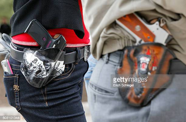 Art and Diana Ramirez of Austin with their pistols in custommade holsters during and open carry rally at the Texas State Capitol on January 1 2016 in...