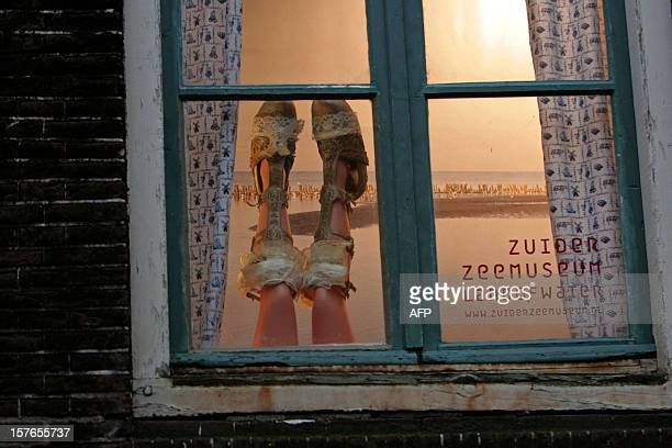 Art and fashion projects replace prostitutes who used to work behind such windows in the red light district of Amsterdam on December 8 2008 Under a...