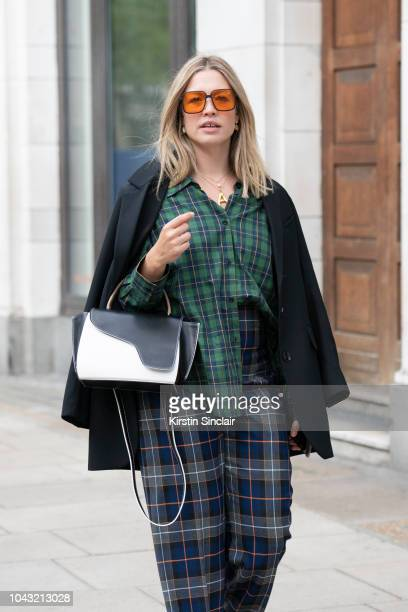Art and Style Director Alexis Foreman wears Zara trousers and shirt HM blazer ATP Atelier bag and Orgreen Optics sunglasses during London Fashion...