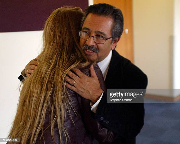 Art Barroso father of Megan Barroso hugs Meagans best friend Lindsay Gross 23 of Moorpark outside the courtroom where Vincent Sanchez was sentenced...