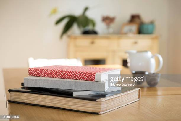 art books on a wood table, nancy, france - stack of books stock photos and pictures