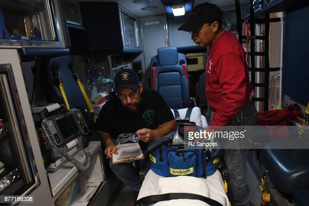Art Brubaker left and Alfonso Rios both volunteer EMTs for Crowley County Ambulance go through a list to make sure the ambulance is supplied with...