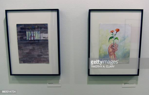 Art by detainee Mohamad Ansi is viewed on November 22 2017 part of an exhibit from Guantanamo Bay Cuba at John Jay College of Criminal Justice in New...