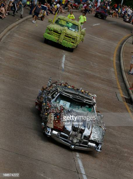 Art cars are seen on Allen Parkway during the 26th Annual Houston Art Car Parade on May 11 2013 in Houston Texas