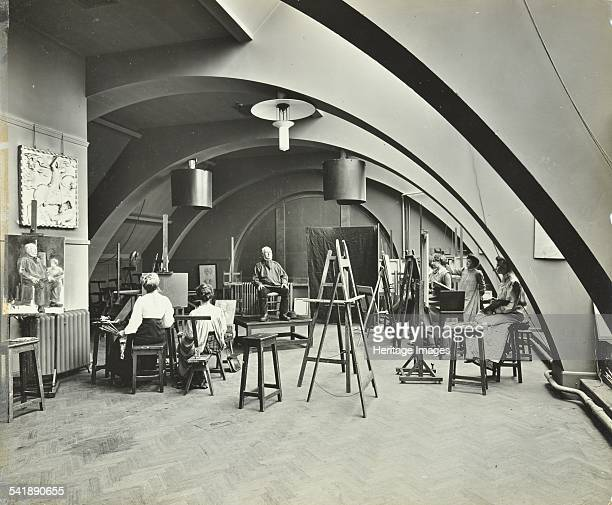 Art class Westminster Technical Institute London 1910 Female students painting a portrait of man from life in a room with a vaulted ceiling Artist...